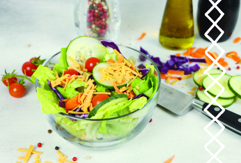 Bowl with green leaf lettuce, cabbage, carrots and the salad fixings with Vevan Shred